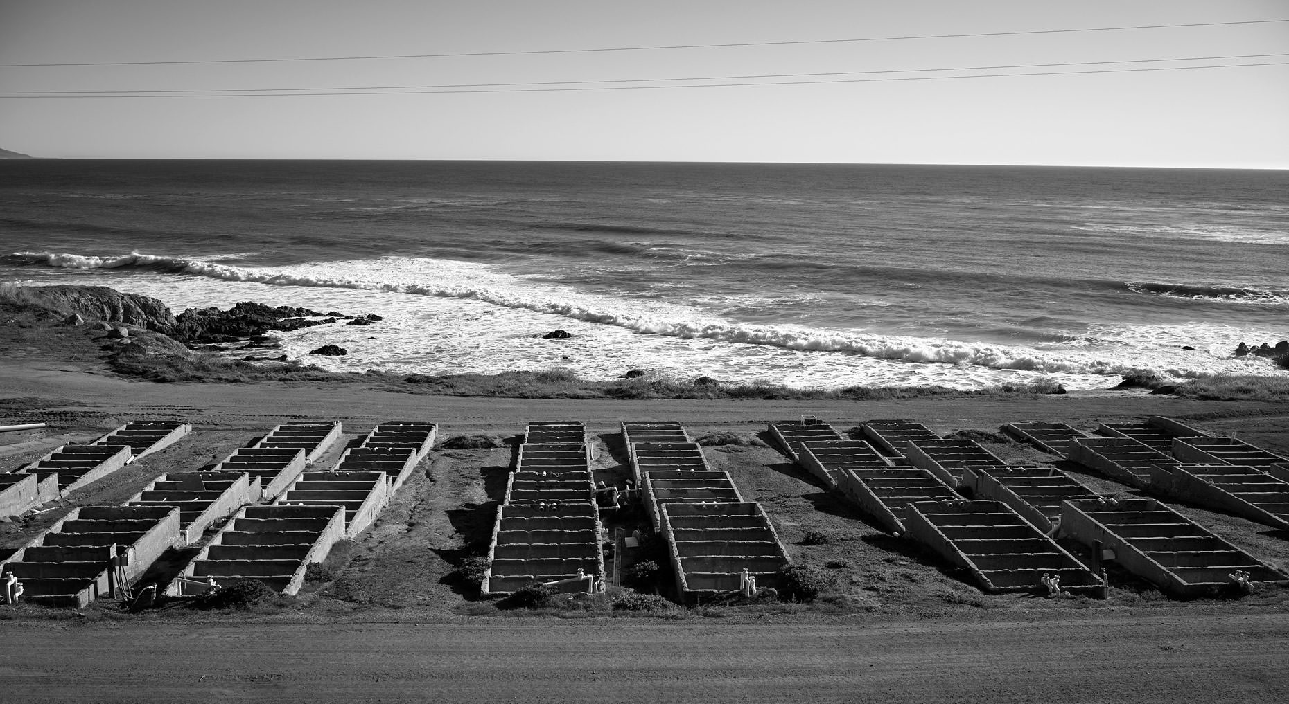 Rows of Unused Abalone Tanks by the Surf