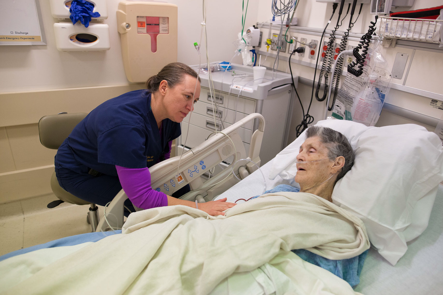 A Nurse Comforts a Patient in the Emergency Room