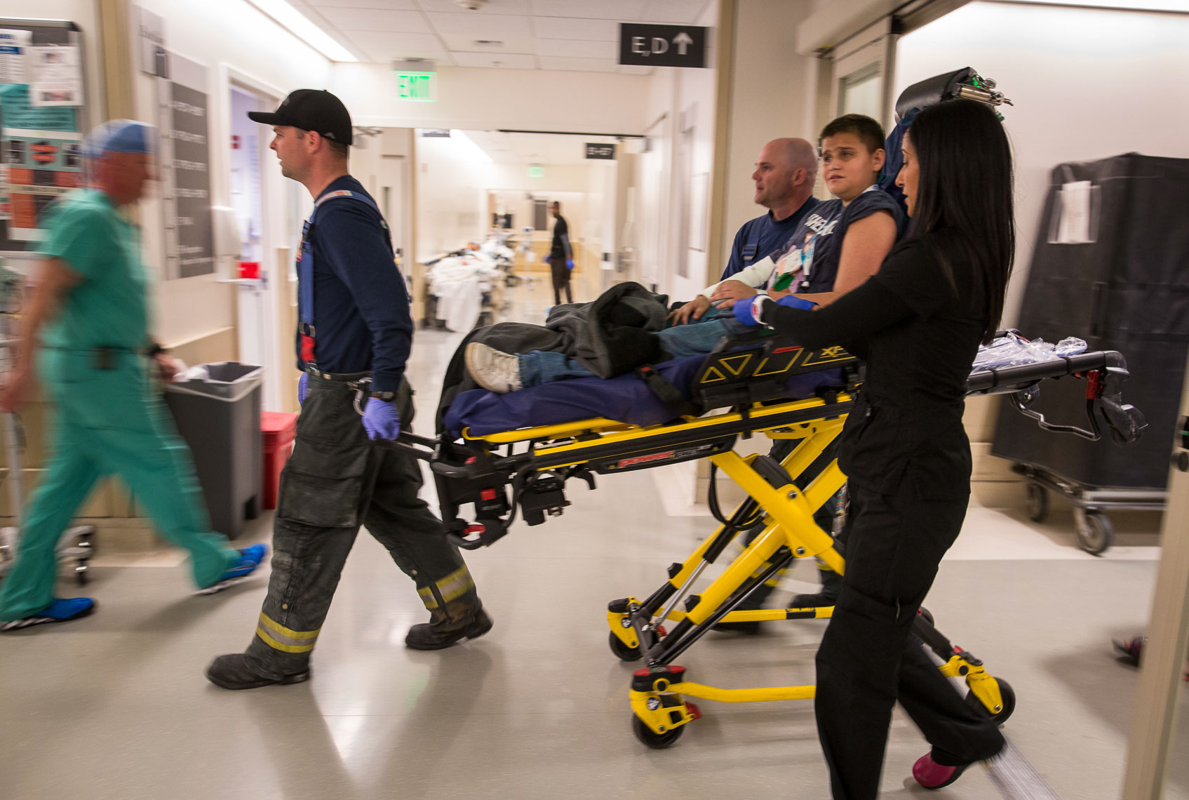Boy Wheeled into Emergency Room by Paramedics