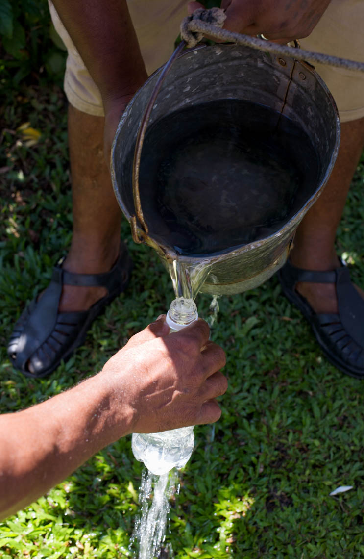 Filling up Bottles with River Water in Fiji