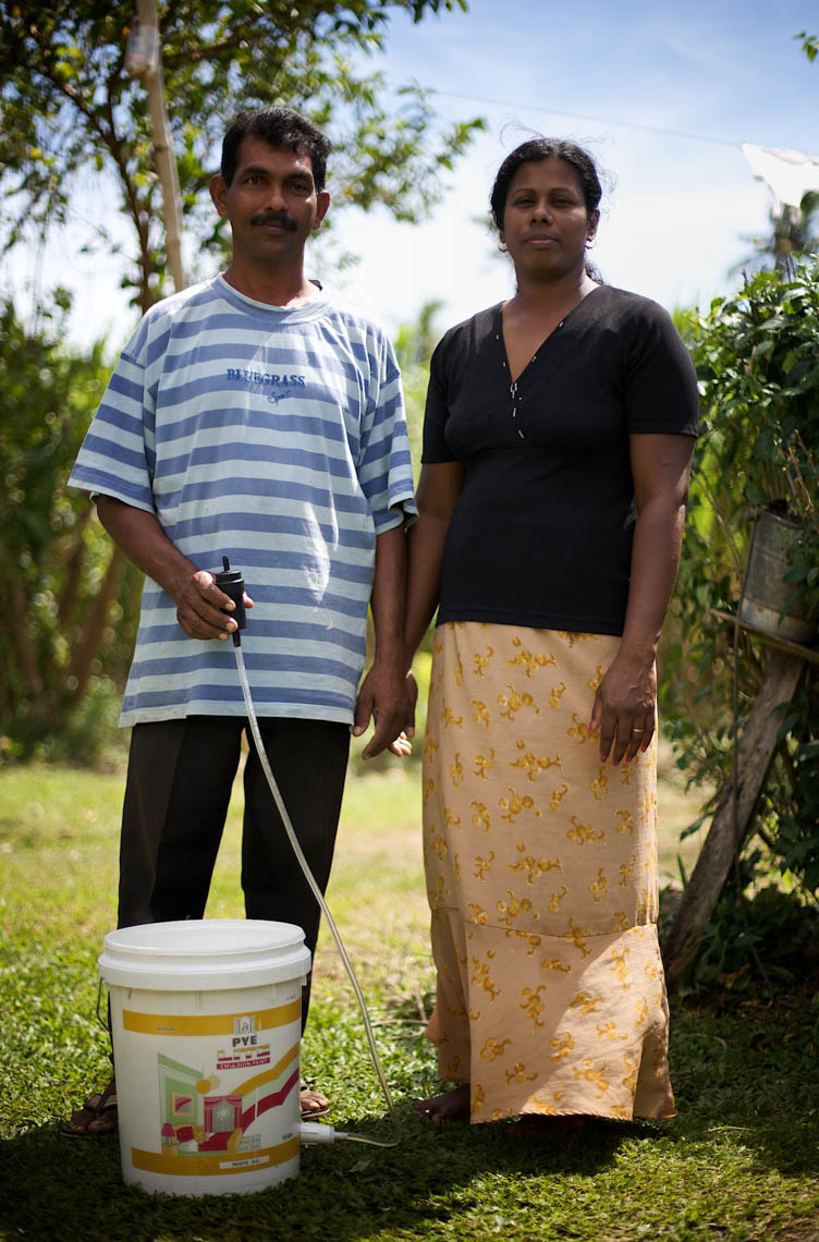 Fijian Couple Pose with Clean Water System