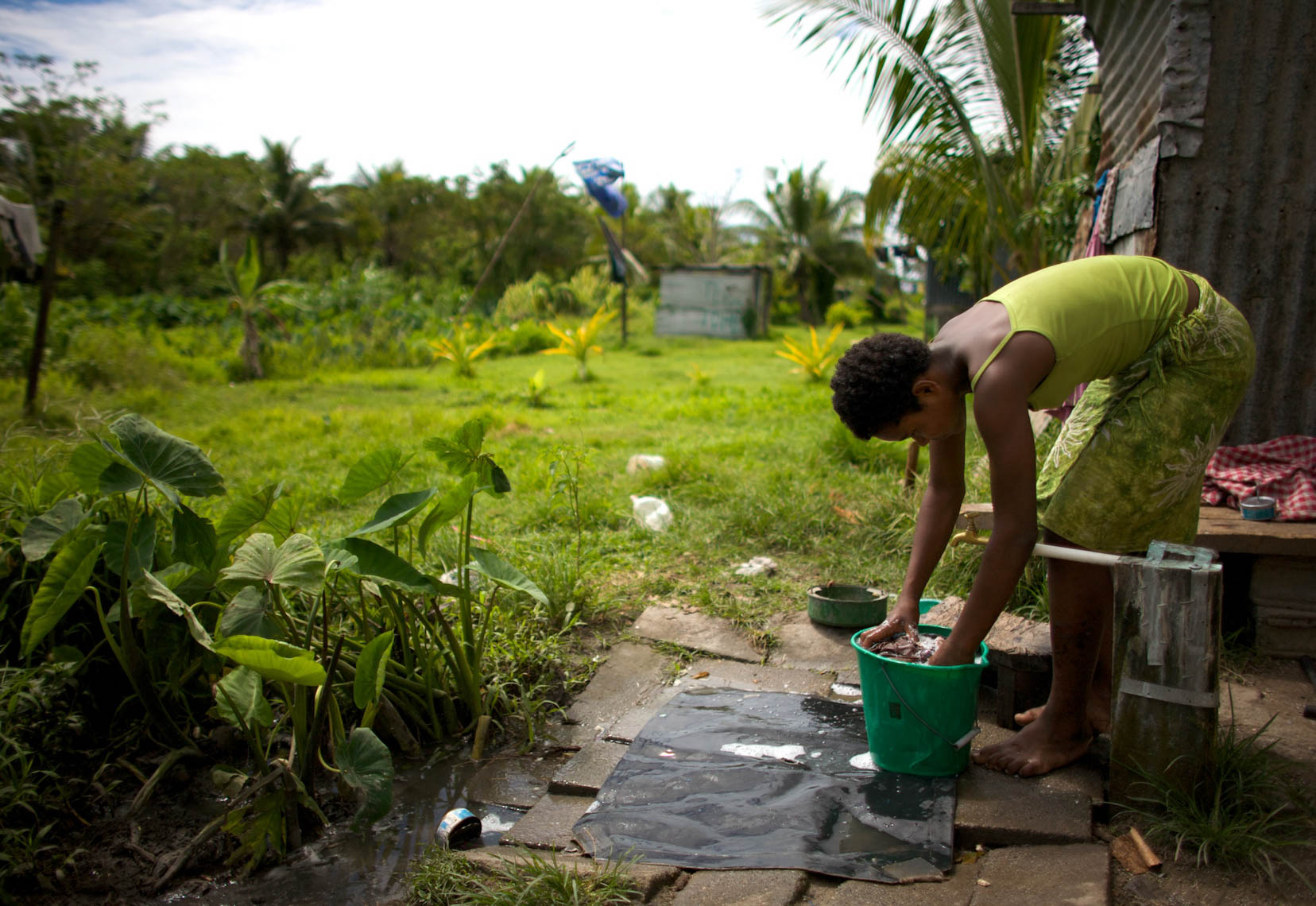 Girl in Fiji Cleaning Clothes
