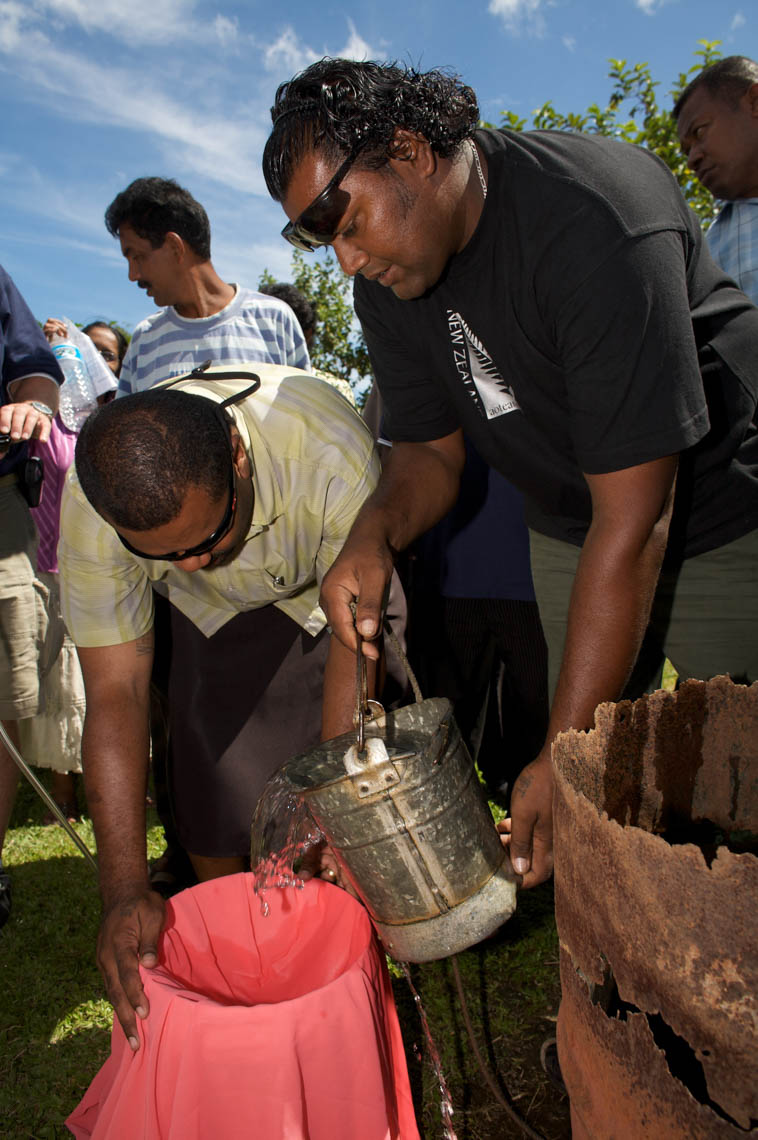 Fijian Men use T-Shirt to Filter Water