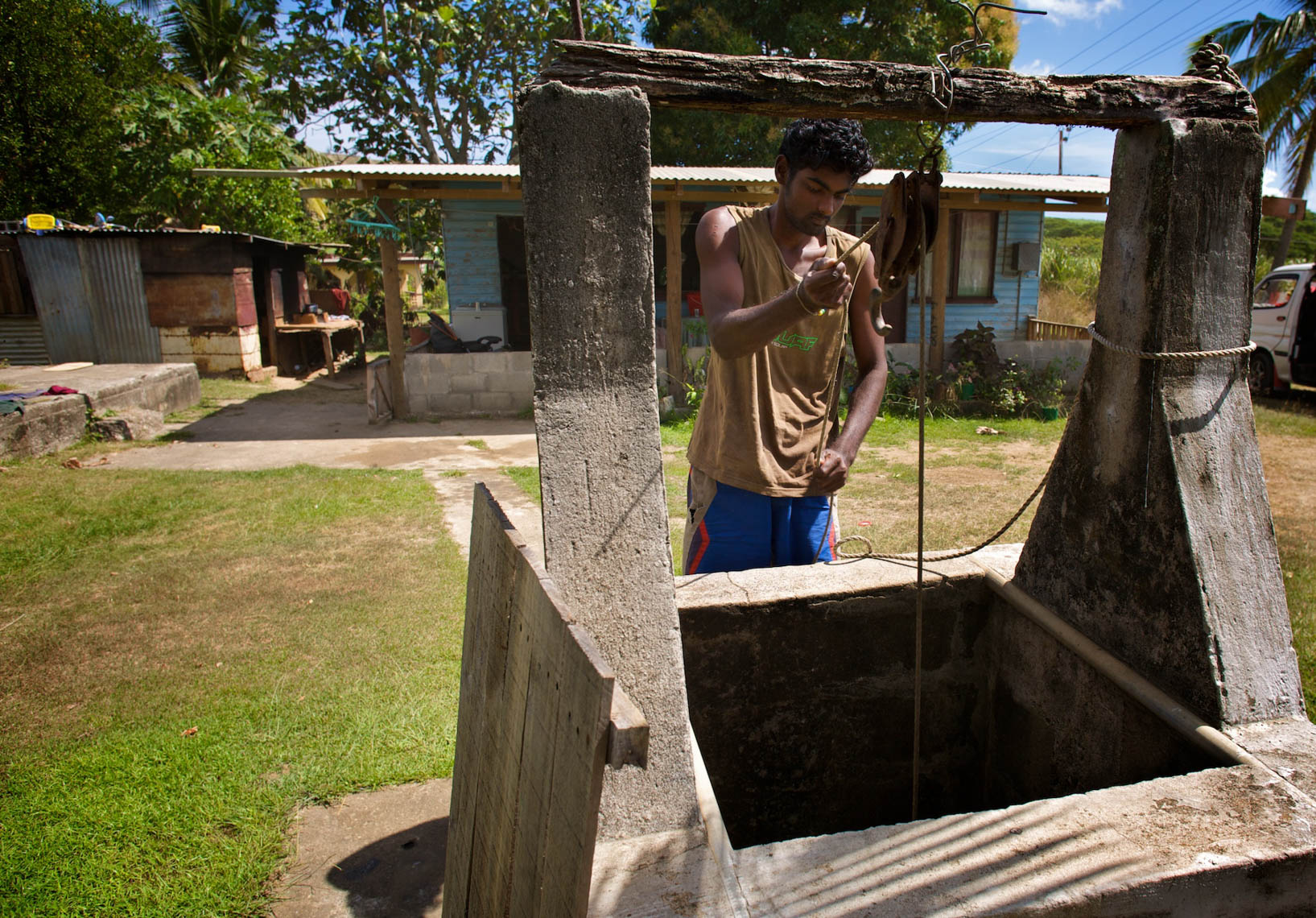 Man Draws Water from Well in Fiji