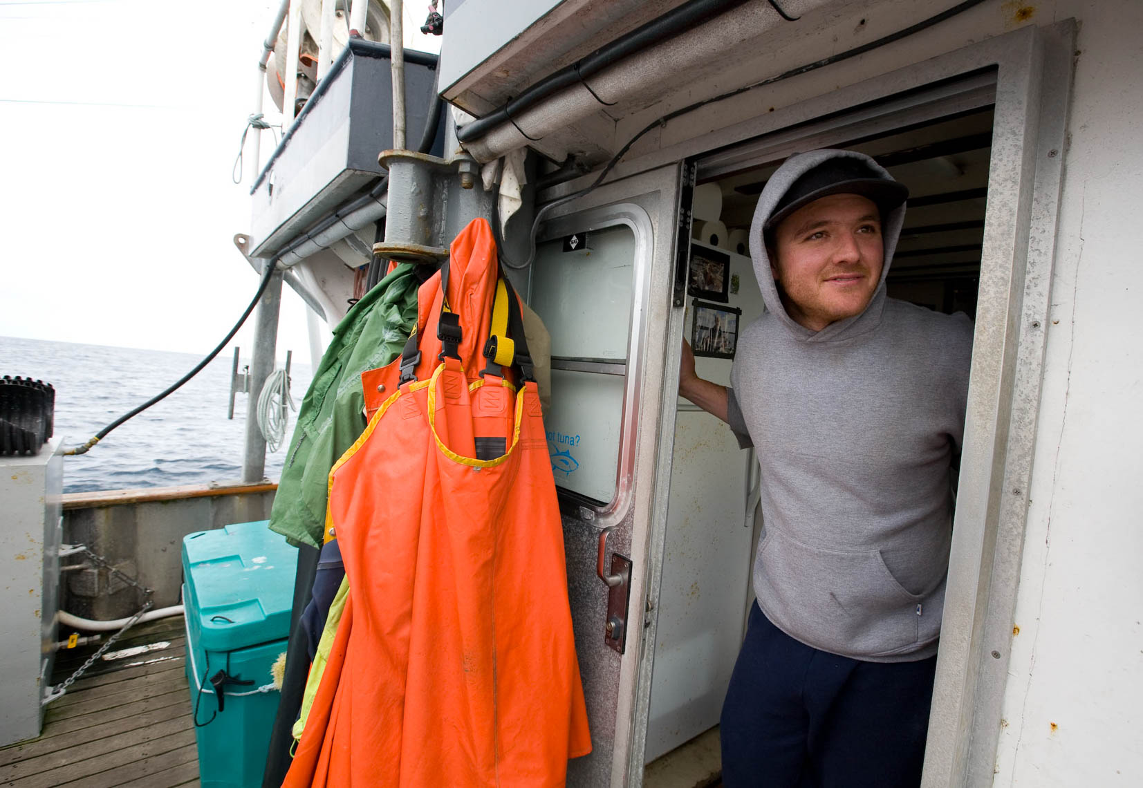 Tuna Boat Crewman Looks Outside