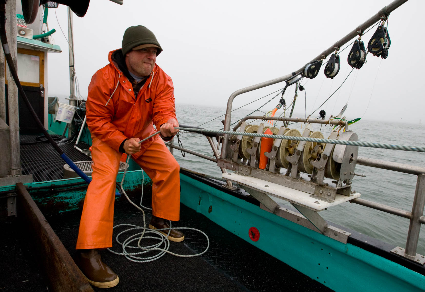Crewman Pulls in Anchovy Net