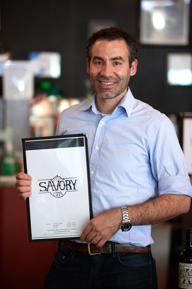 Chef Juan Barajas with Savory Cafe Menu