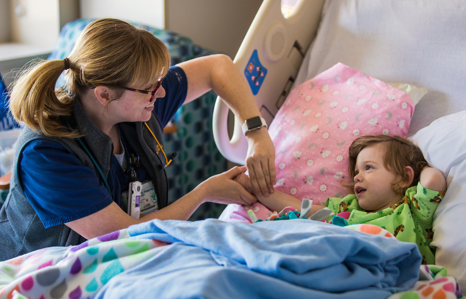 Nurse Cares for Pediatric Patient