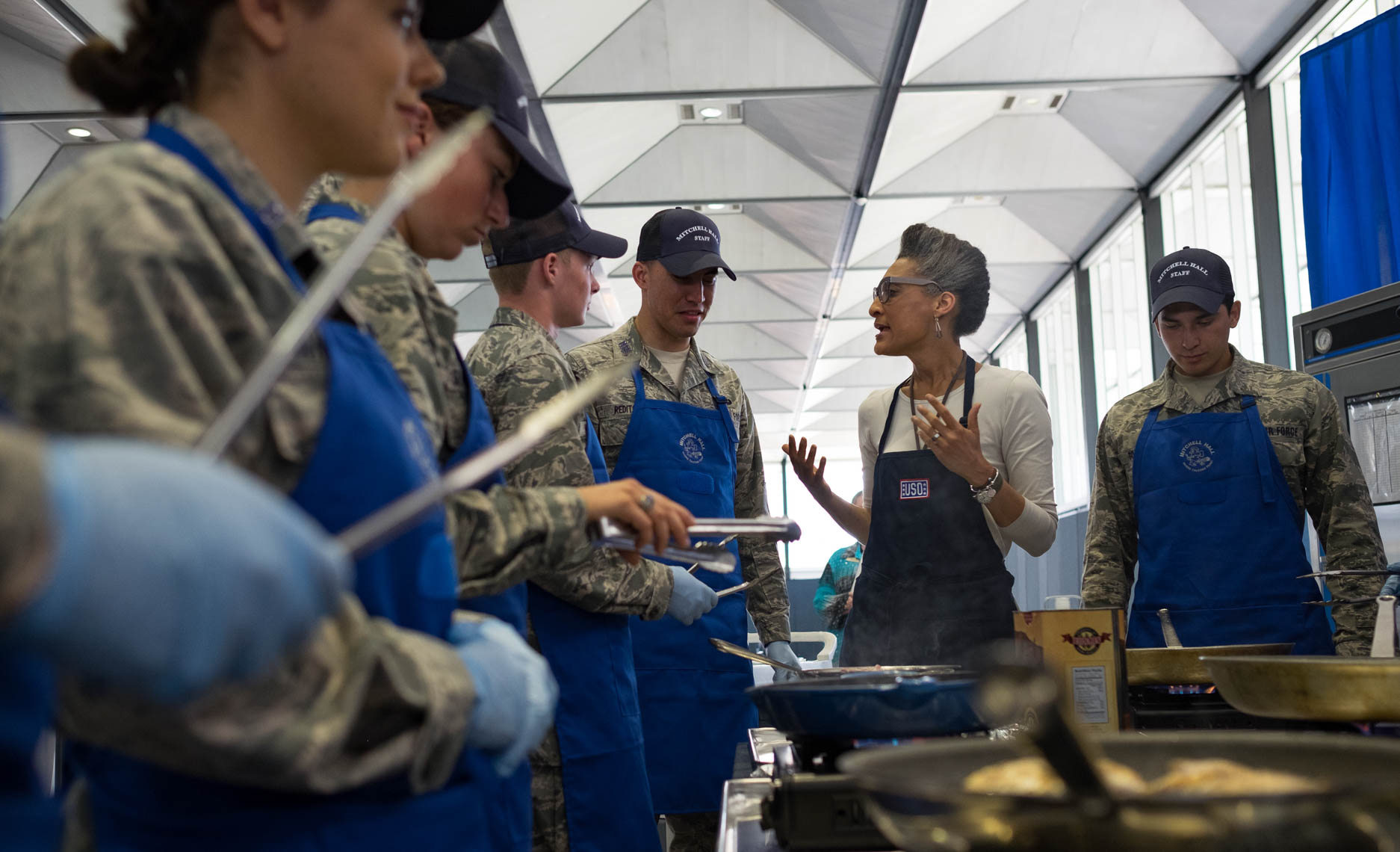 USO Chef Carla Hall teaches cooking skills to Air Force cadets