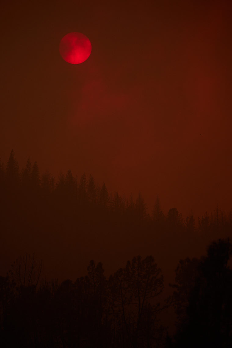 Sun Appears Red Through Heavy Smoke From Wildfire