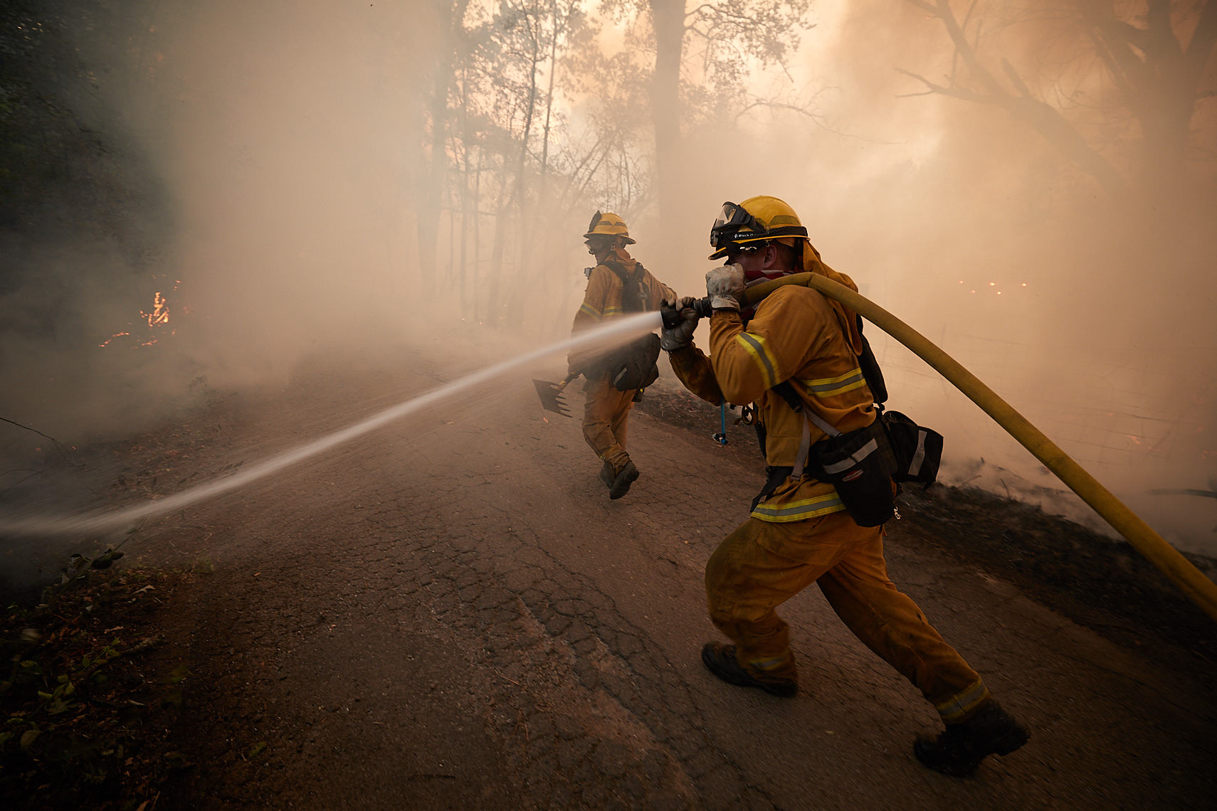 Firefighters protecting homes