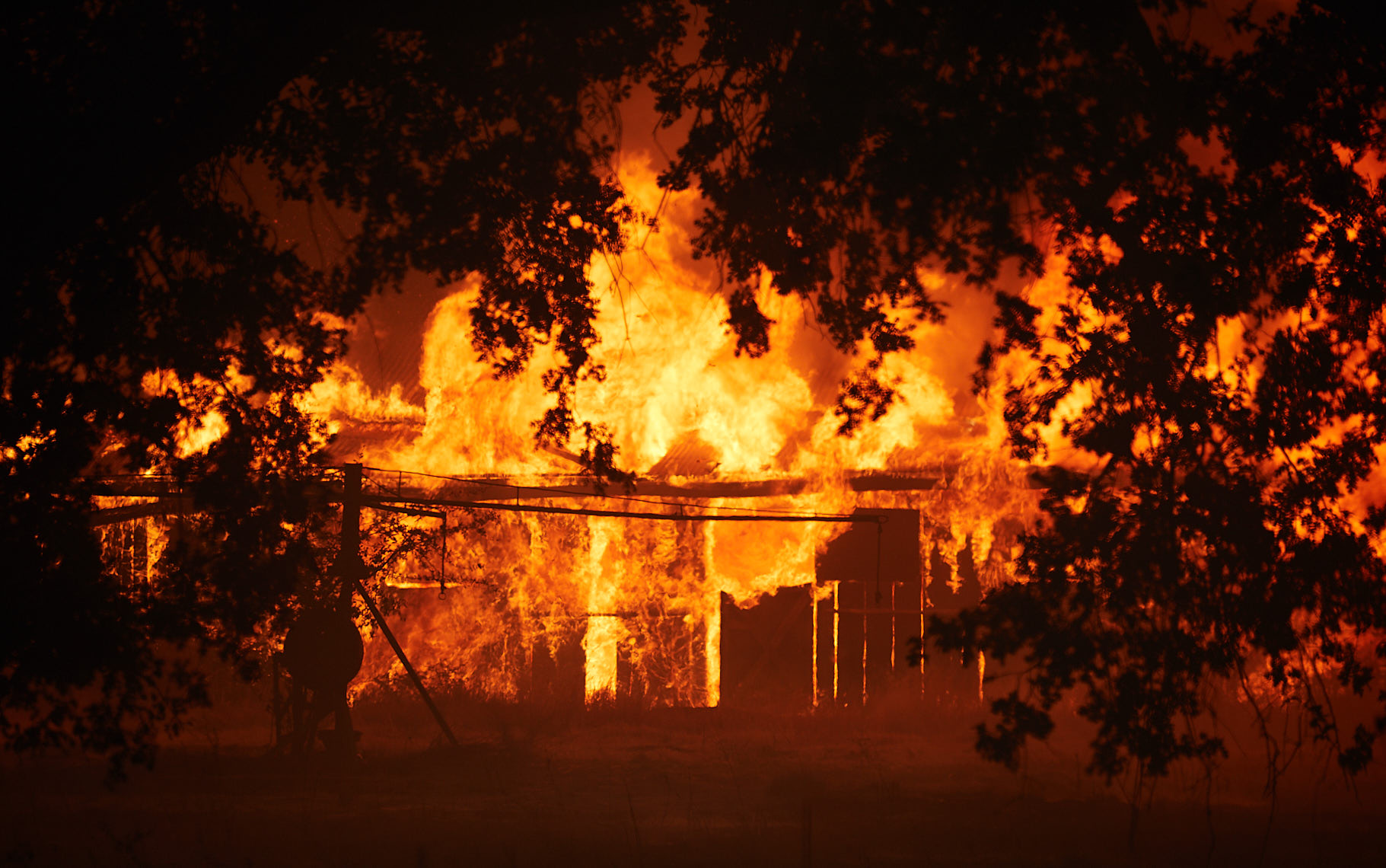 Fire Destroys a Home During Wildfire