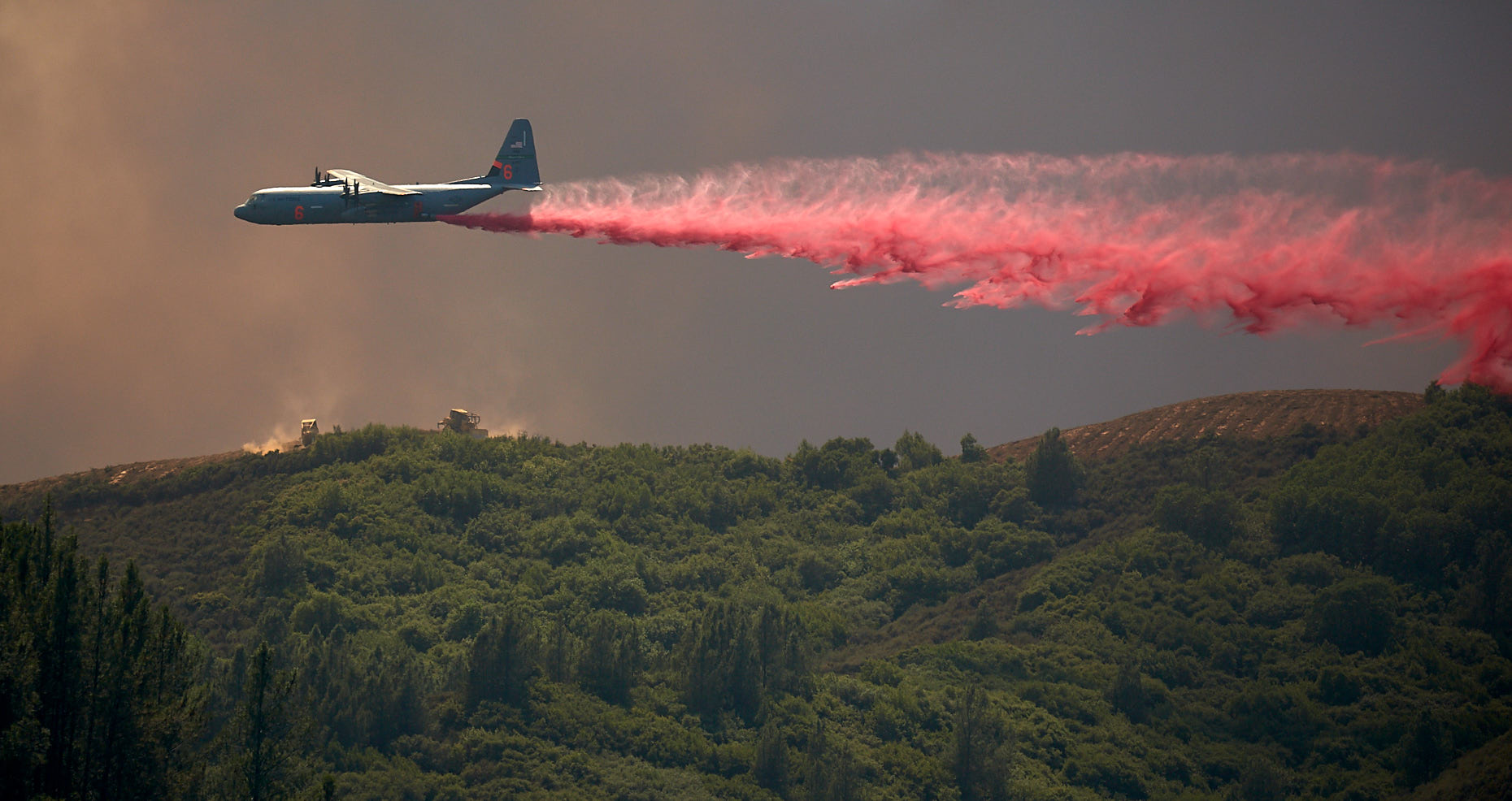 Fire Bomber Protects Crew with Retardant Drop