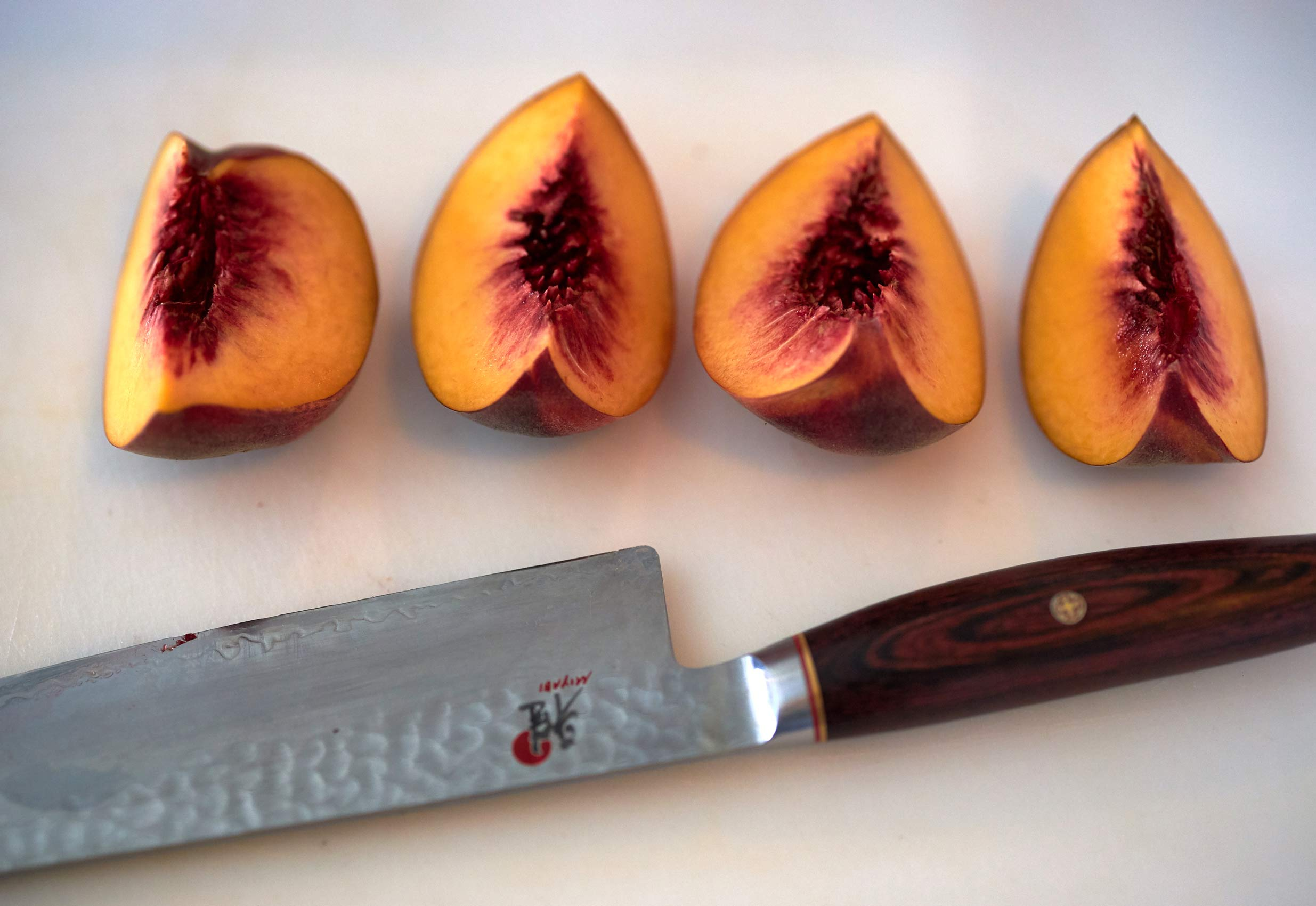 Sliced Peaches and Knife