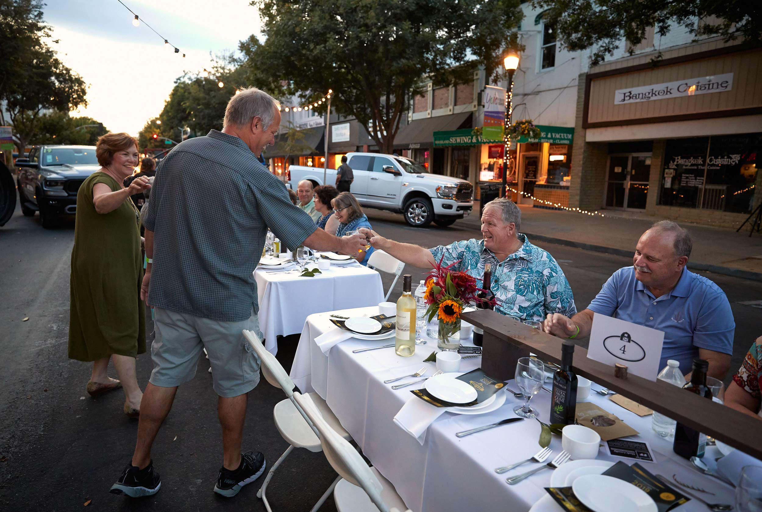 Diners Greet Each Other on Main Street