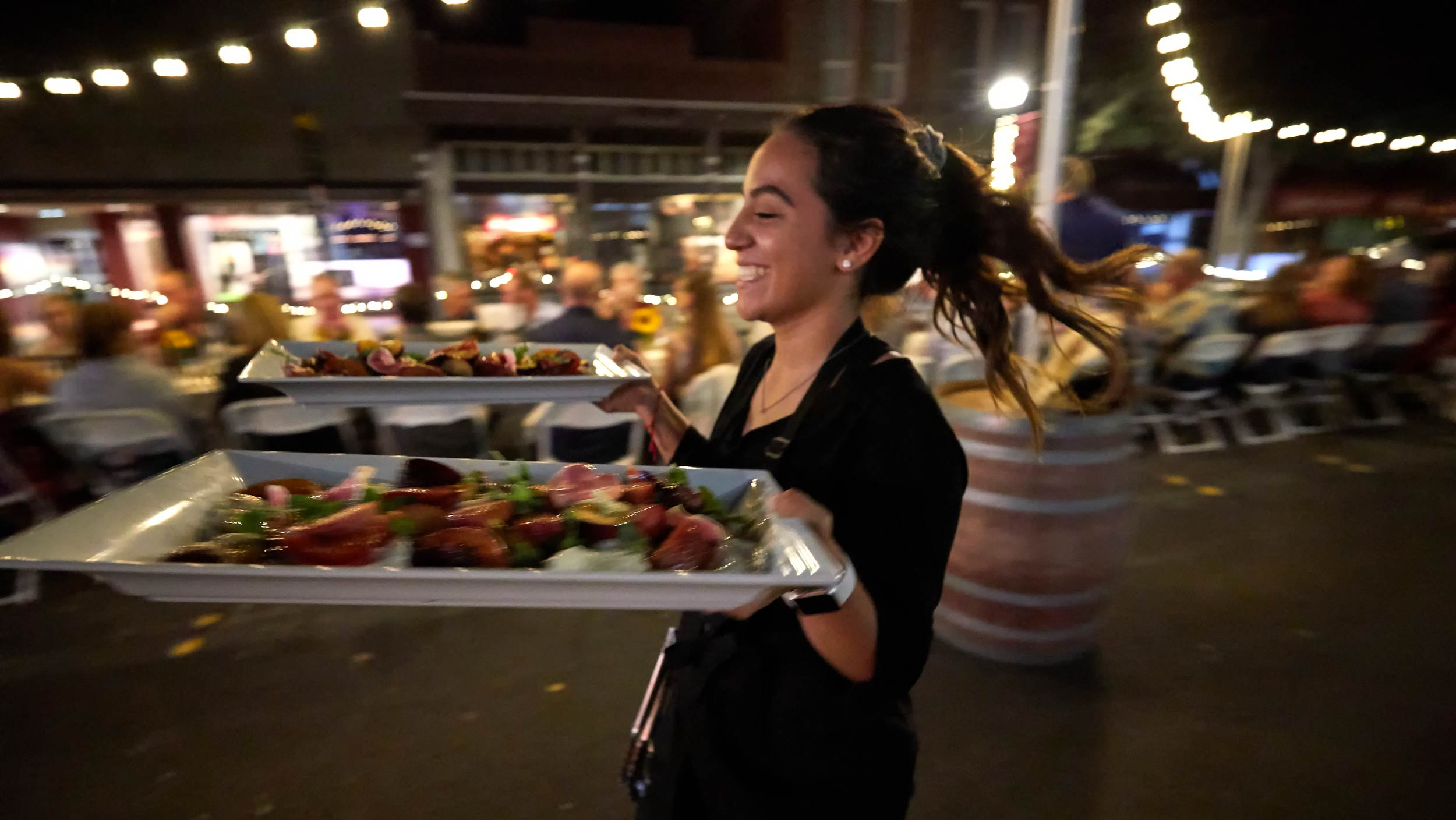 Server Brings Salad to diners at Dinner on Main