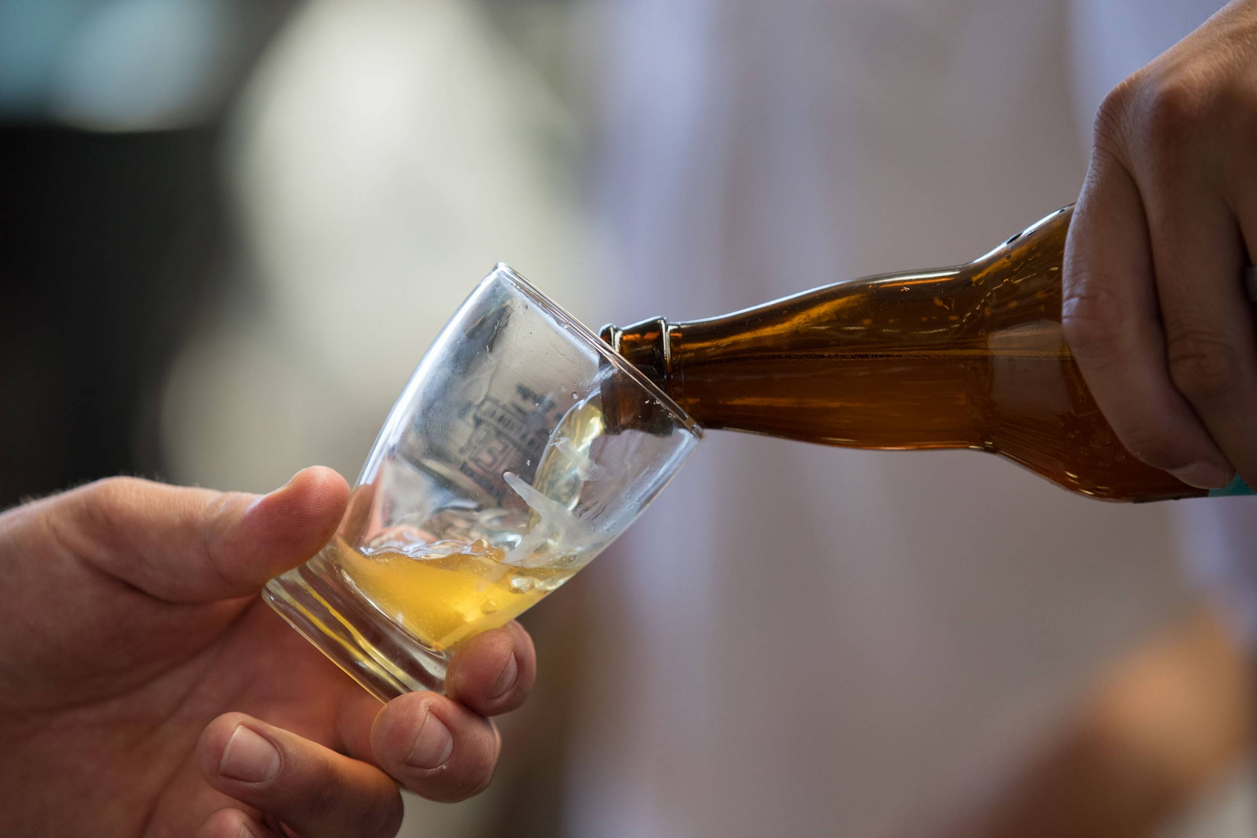 Beer Poured into Glass at San Diego International Beer Festival