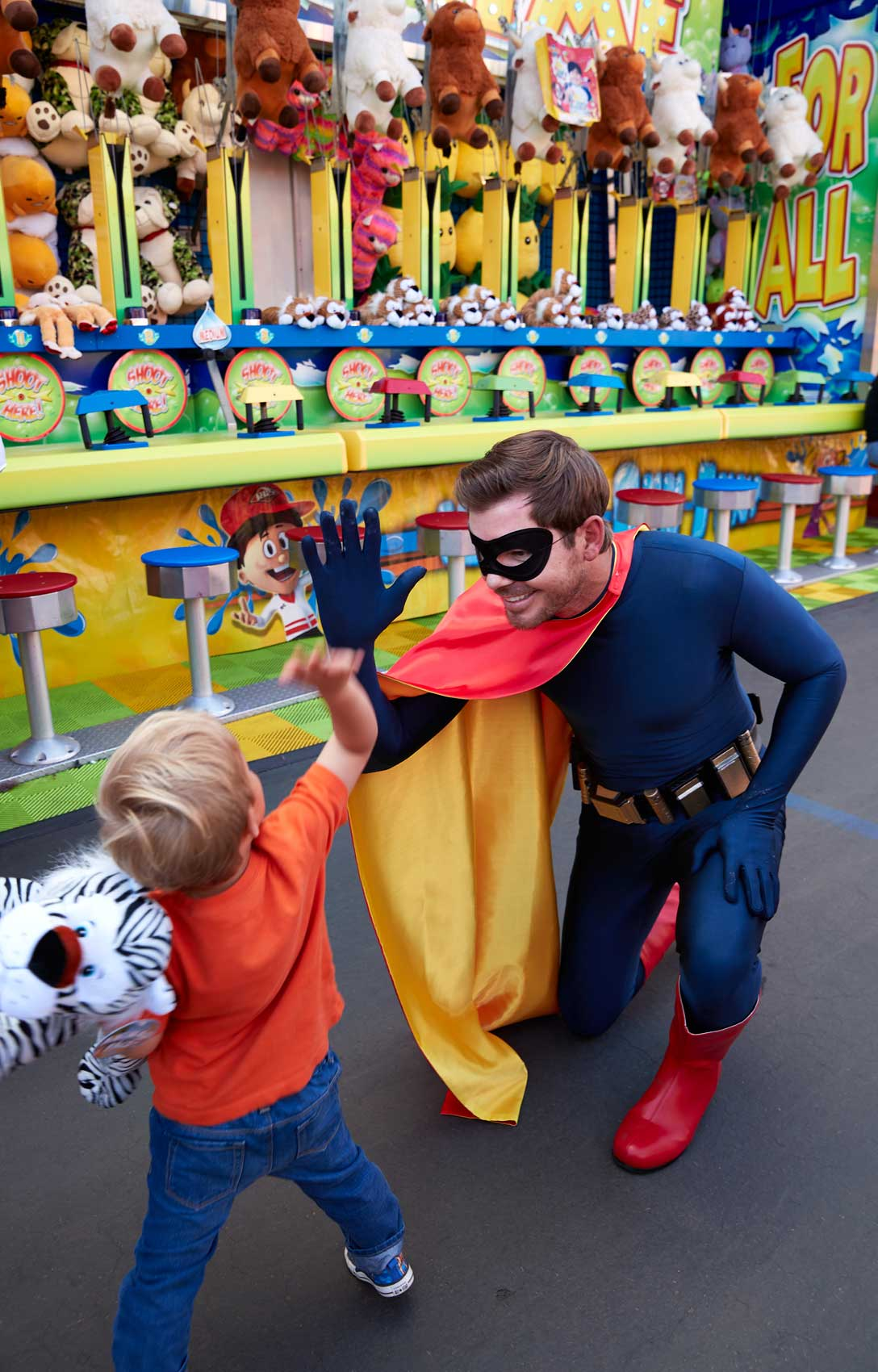 Superhero High Fives a Child