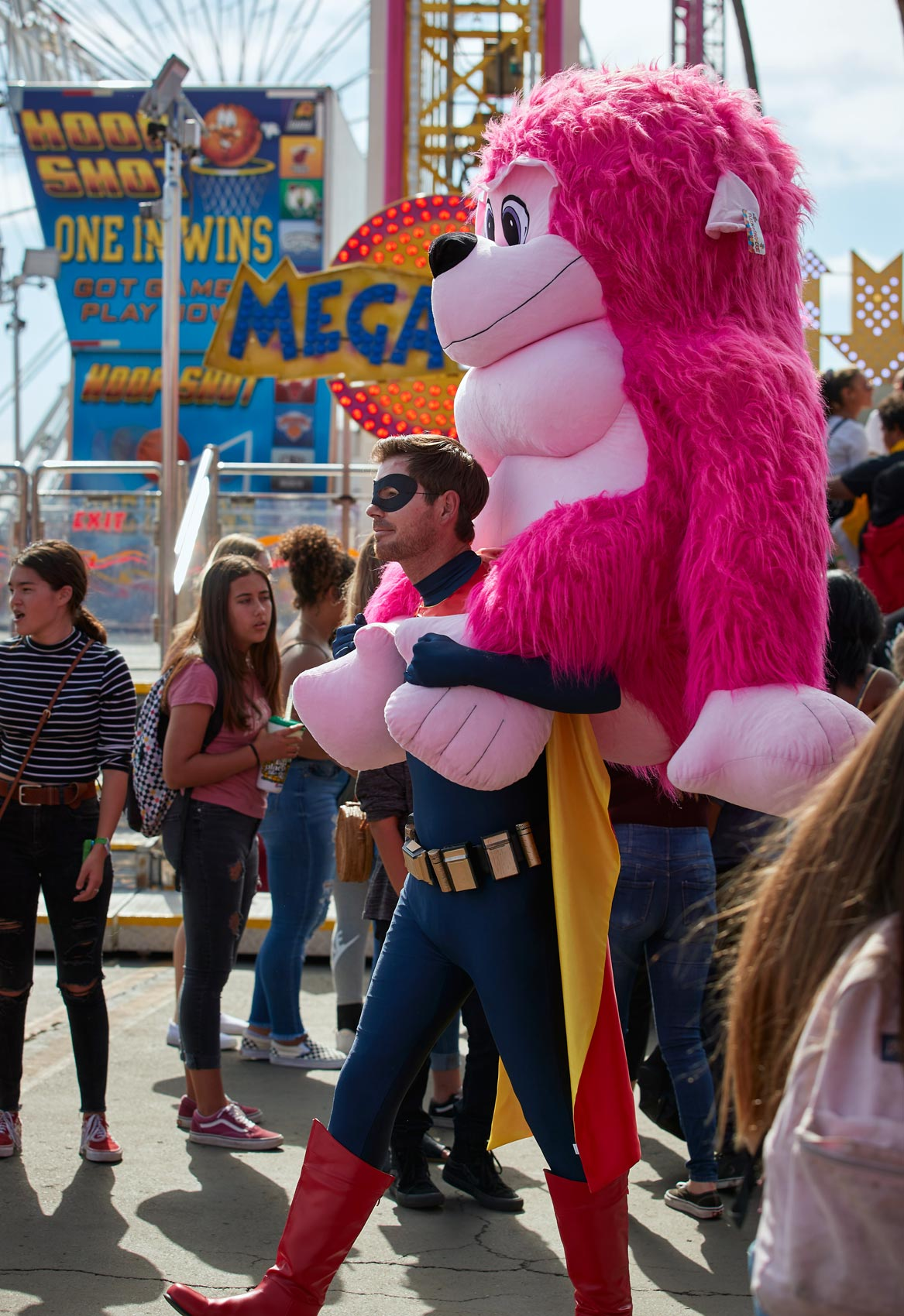 Superhero in Crowd with Pink Gorilla