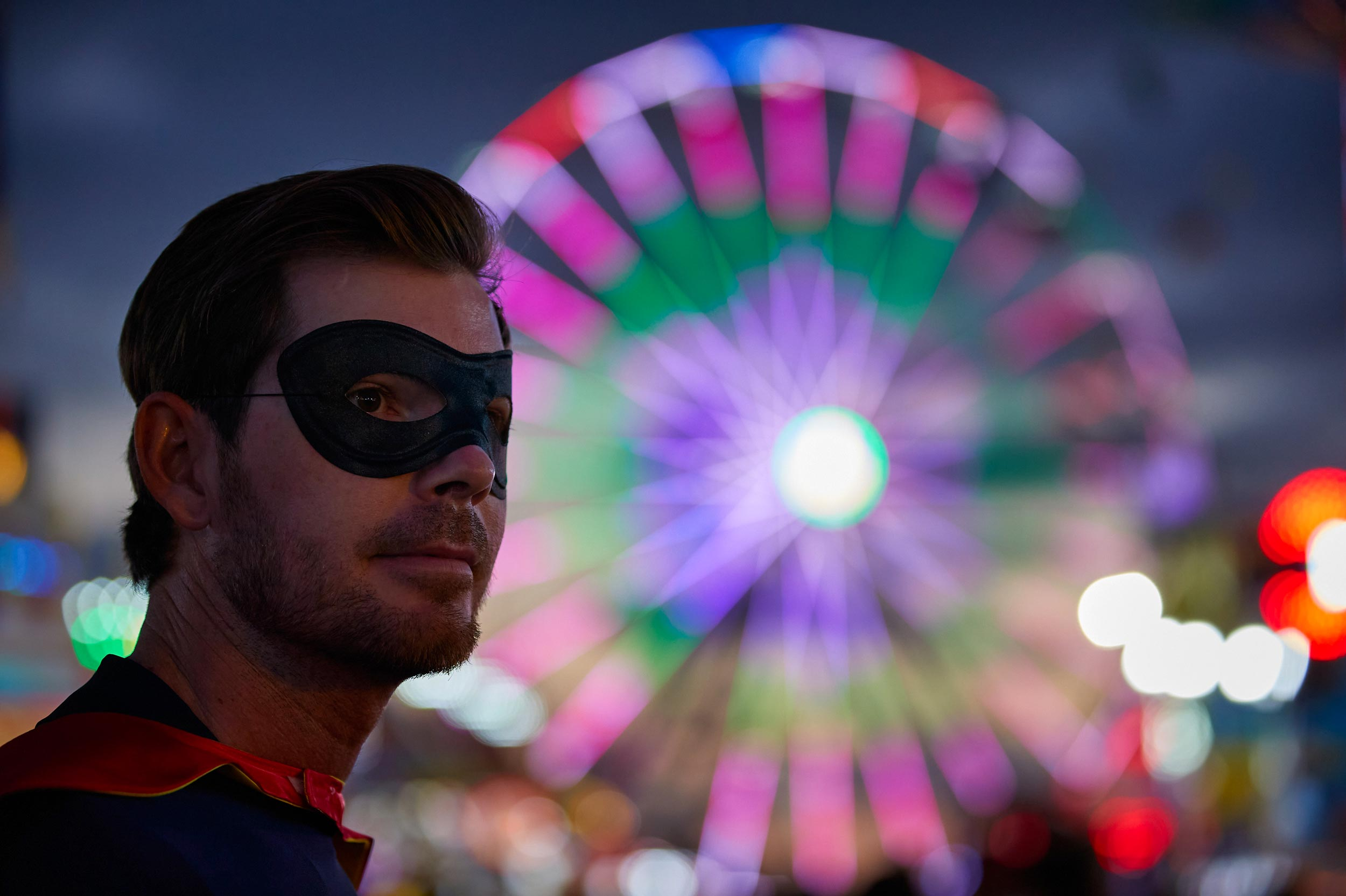Superhero Near Nighttime Ferris Wheel