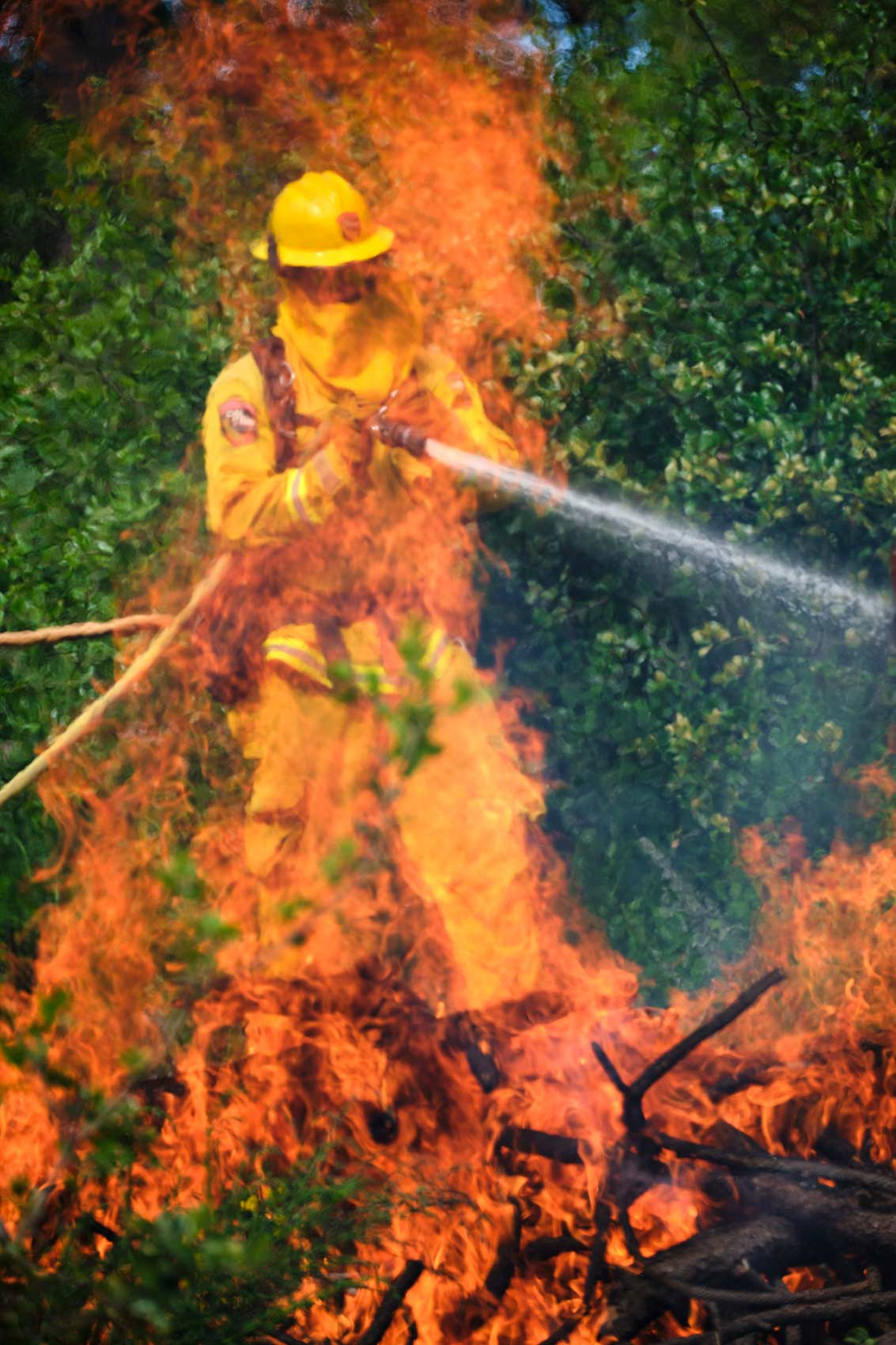 Firefighter Hoses Down Fire Through the Flames