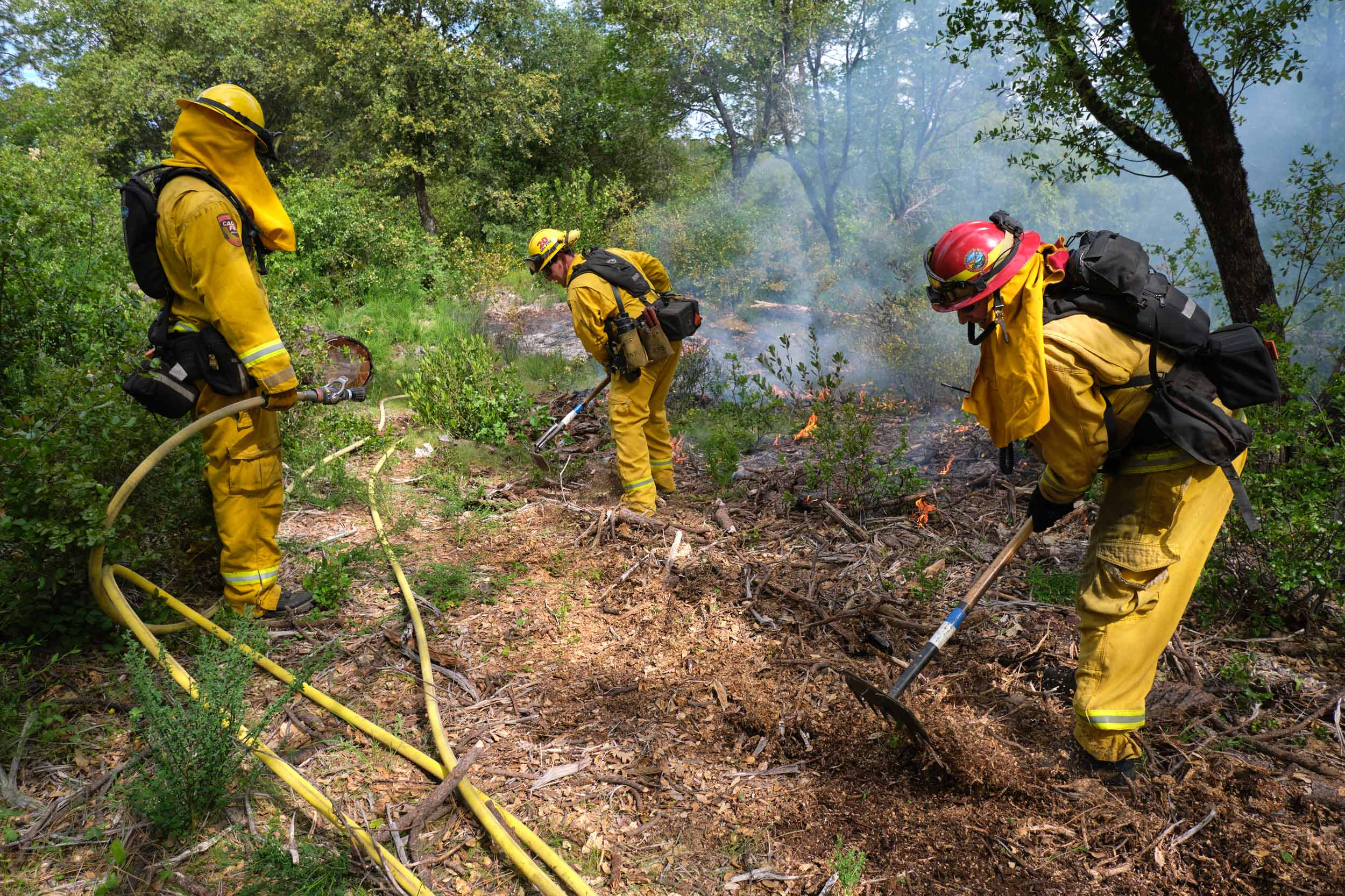 Firefighters Manage a Controlled Burn