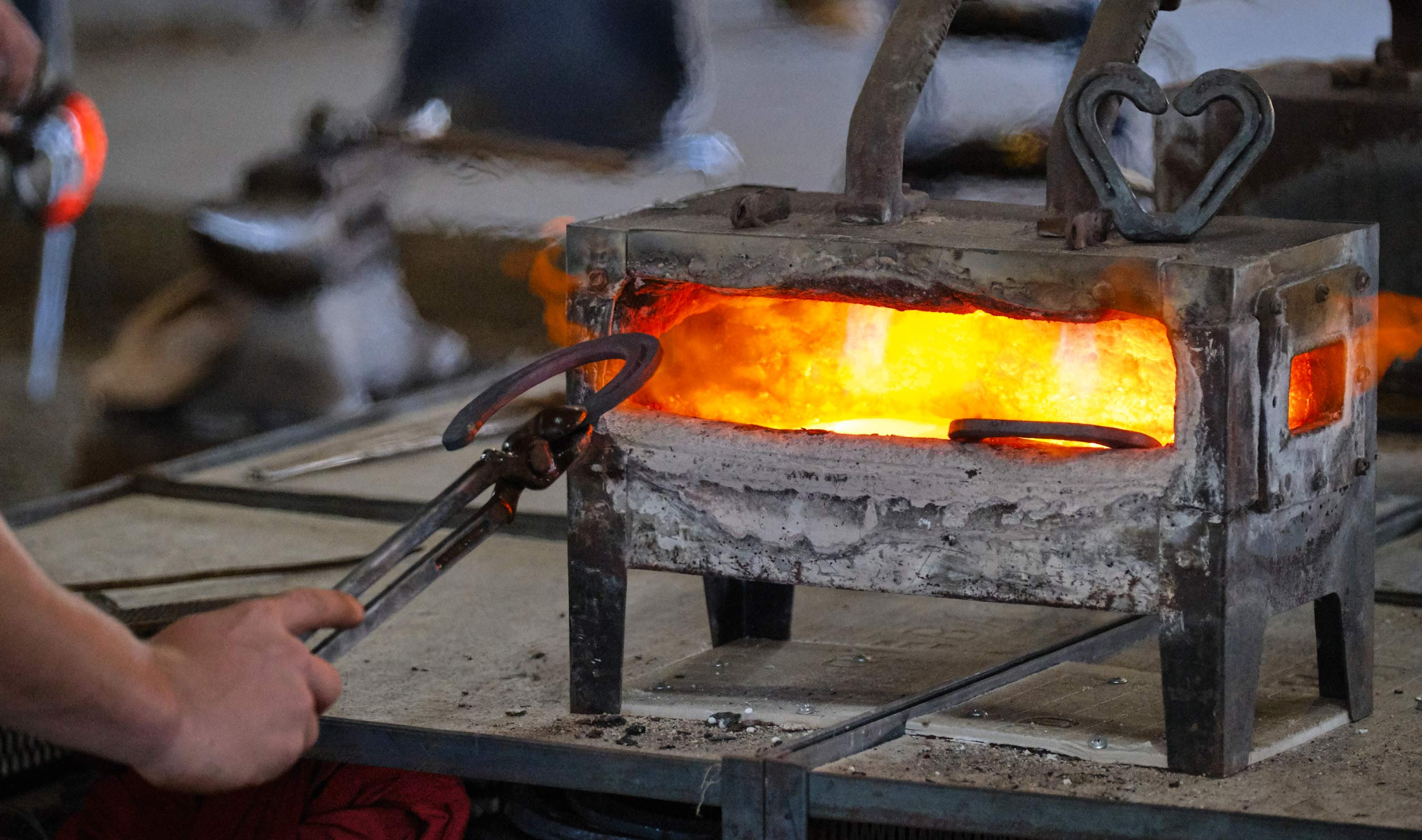 Student Pulls Horseshoe out of Forge