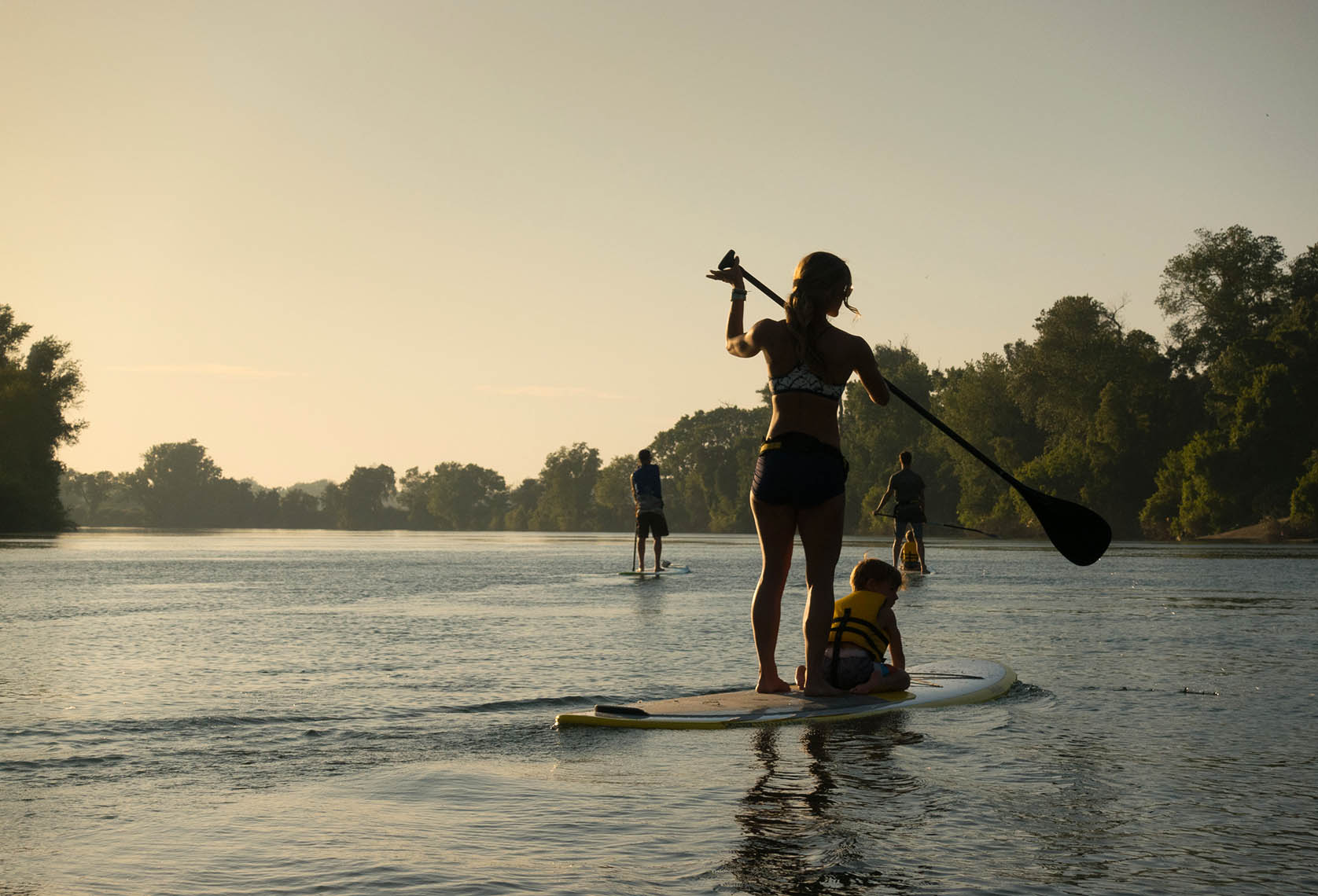 Paddleboarders on the Sacramento River at Dusk