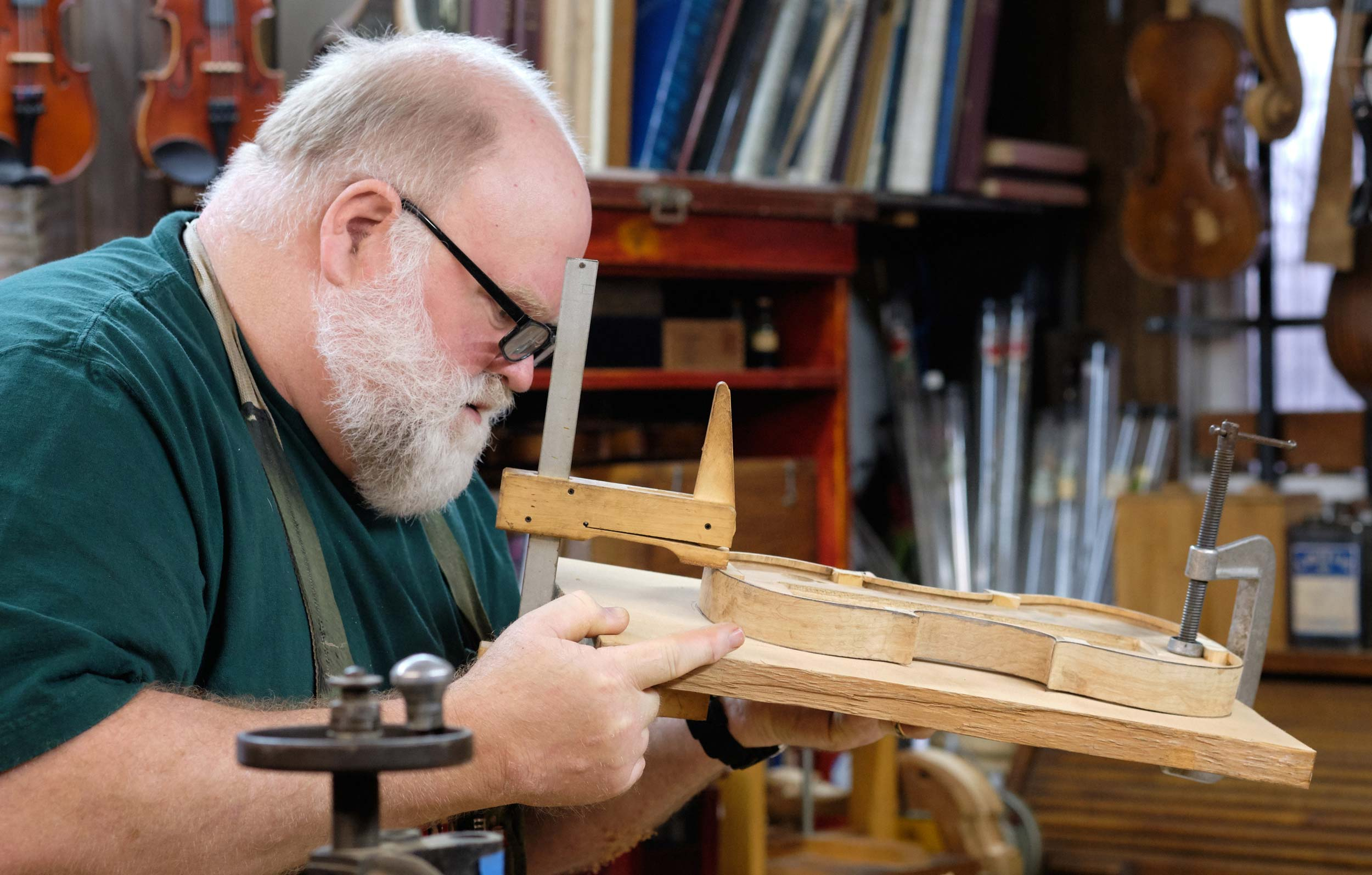 Violin Maker Inspects Template