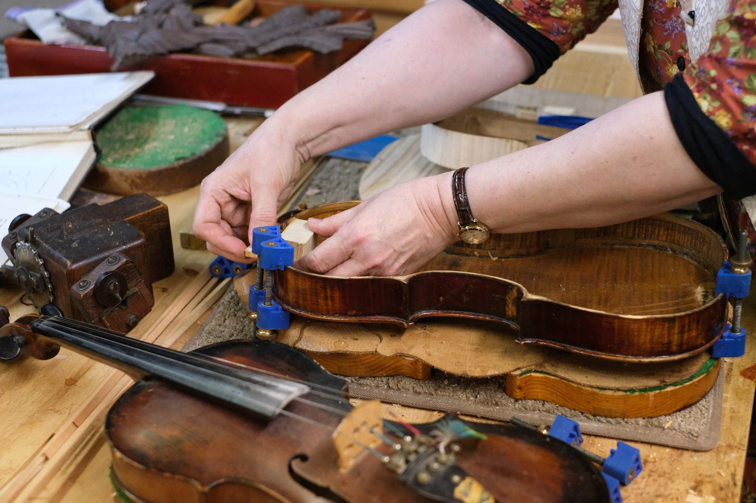 Violin is Clamed into a Frame for Repairs
