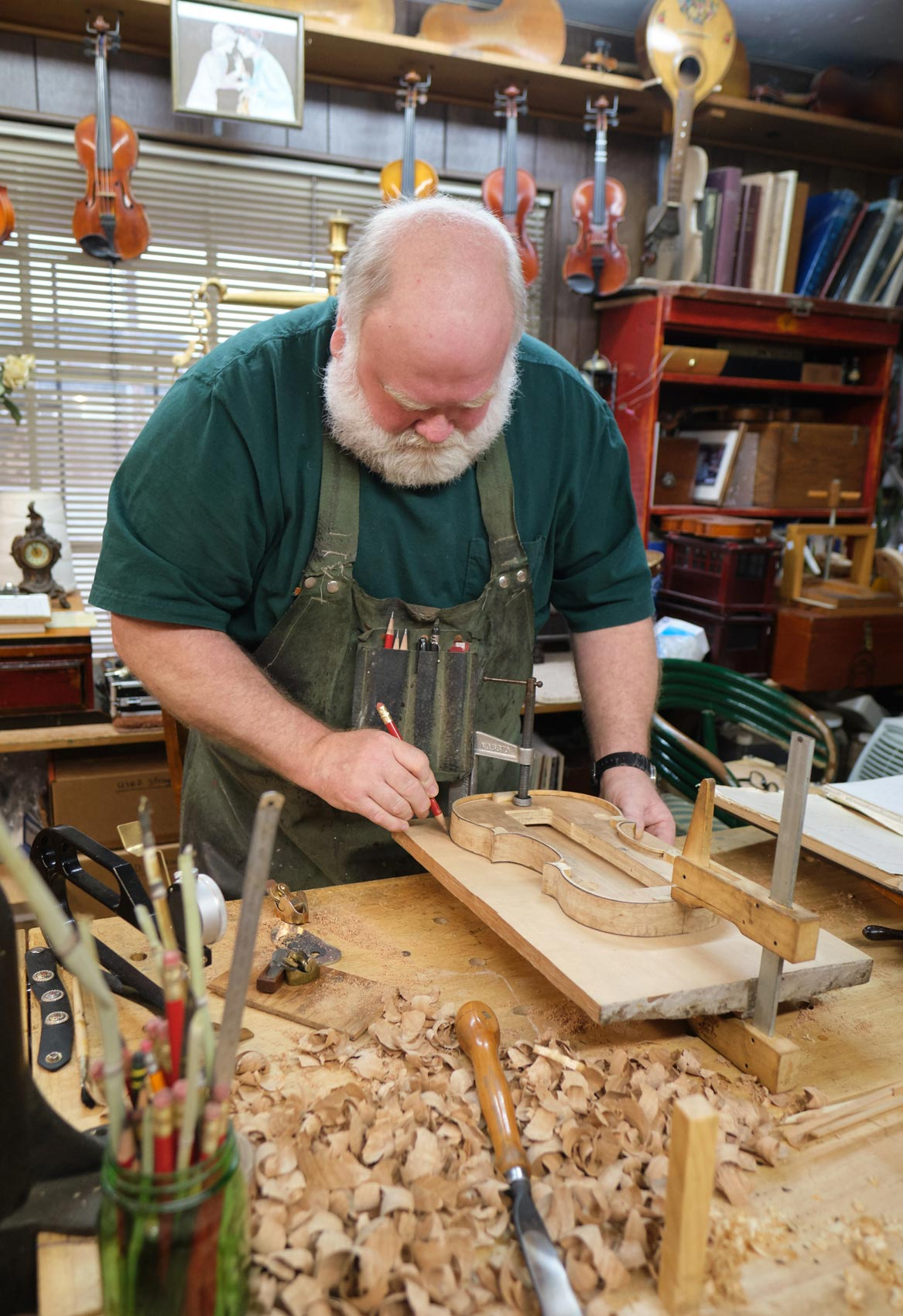Violin Maker Traces Shape for new Violin