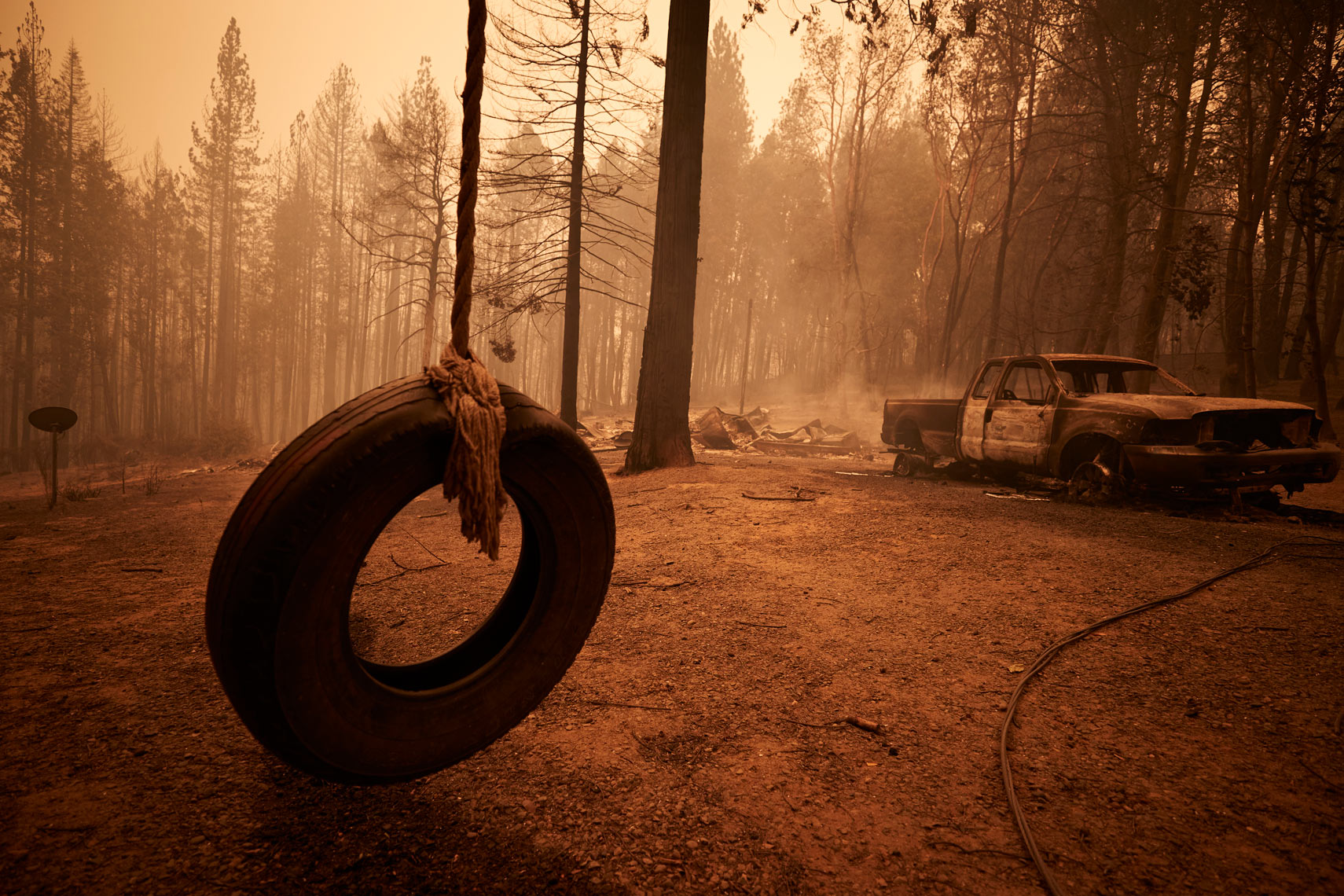 A Tire Swing and Burned Car after Wildfire