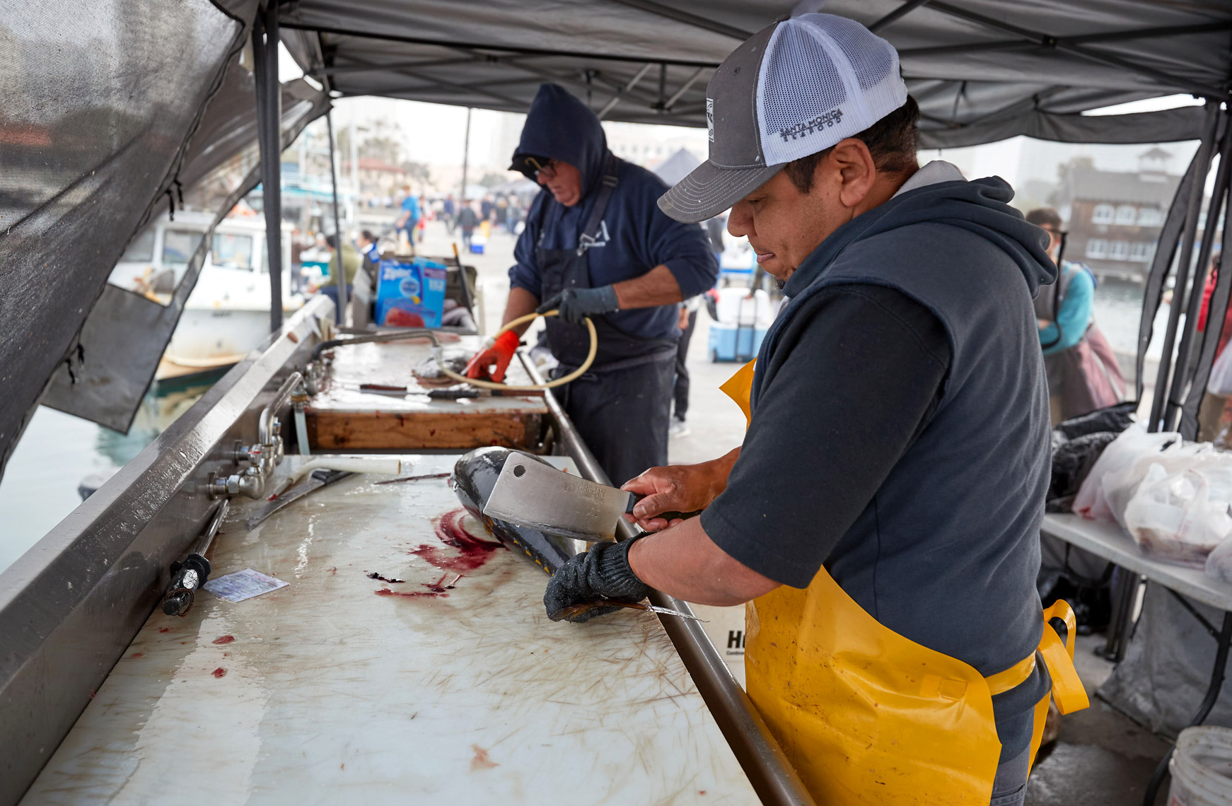 Worker Cuts Fish for Customers